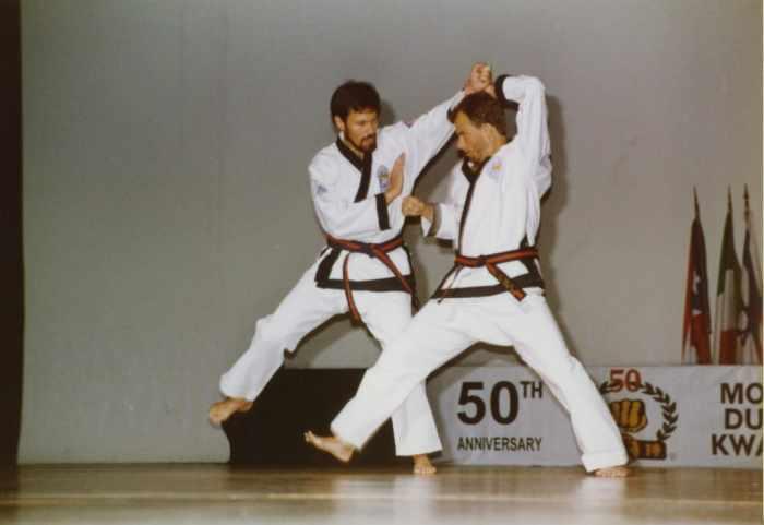Frank Schermerhorn Sa Bom Nim and Williams Johns Sa Bom Nim demonstrating at the Moo Duk Kwan 50th Anniversary in Korea