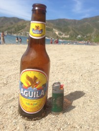 Catching some sun on Taganga Beach, Colombia with an Aguila