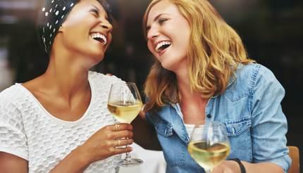 Two friends enjoying white wine