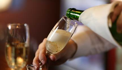 Bartender pouring champagne into glass
