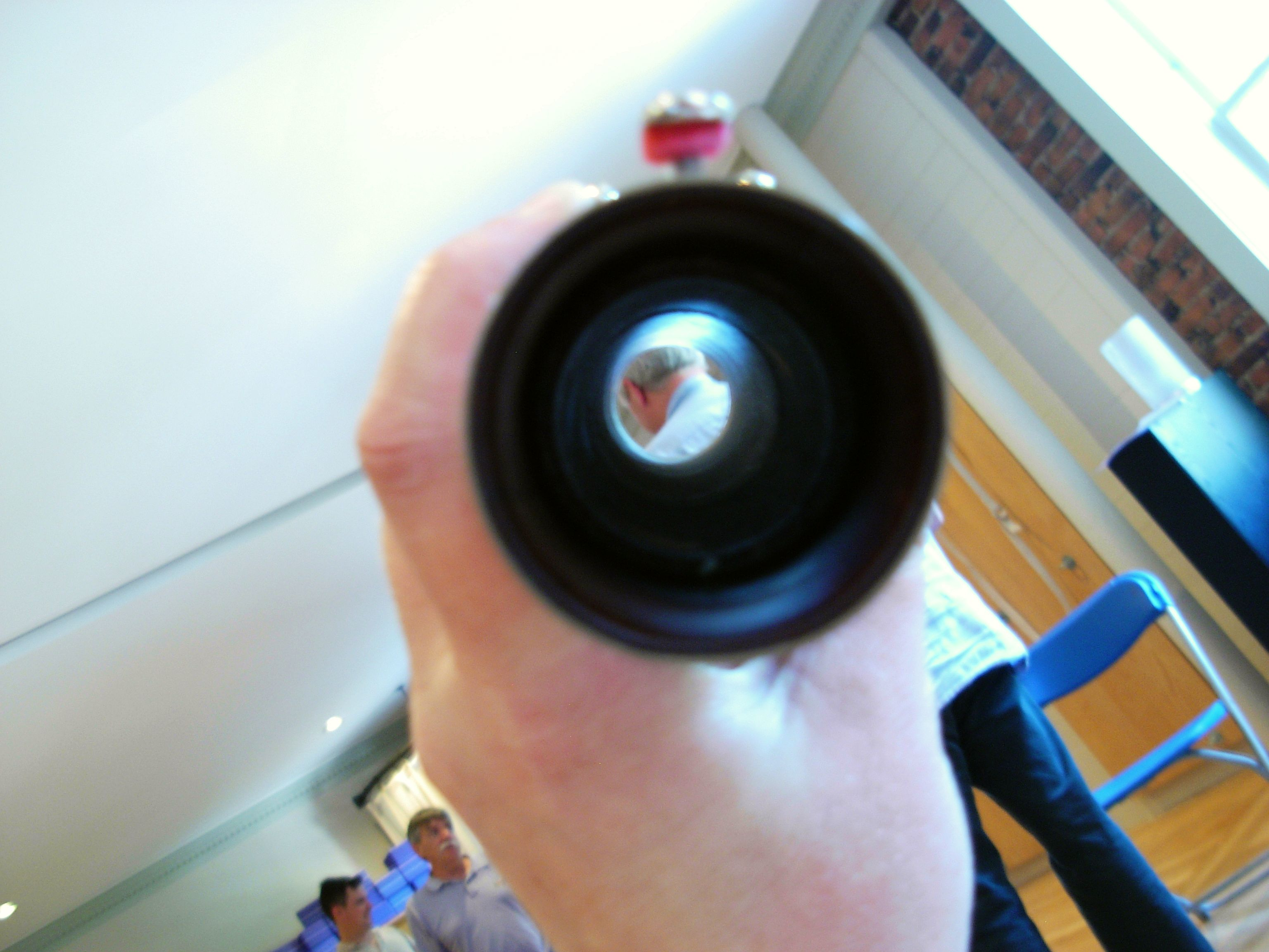 8/3/09 - Andrew Schwartz, as viewed through a segment of his own bassoon.