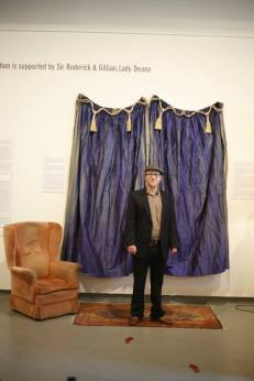 Freeman White in front of his vampire portraits yet to be unveiled