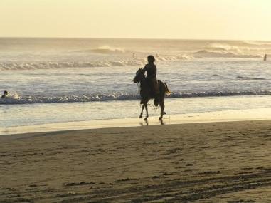 Nicaraguans love their horses! This shot is of a local enjoying the sunset at Masachapa Beach.