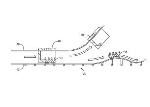 Side view of a motivating portion of a ride attraction path utilized to propel a ride vehicle backwards where the launch room vehicle is hanging from a path above the ride vehicle's path (United States Patent and Trademark Office)