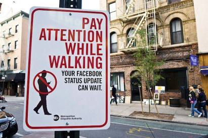 Pay attention while walking -- your Facebook status can wait. USA