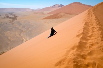 Running down Dune 45 in Sossusvlei (Dead Vlei is located in larger area of Sossusvlei), Namibia
