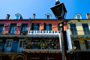 Jazz piano keys artfully created atop a fence on a residential street in the French Quarter