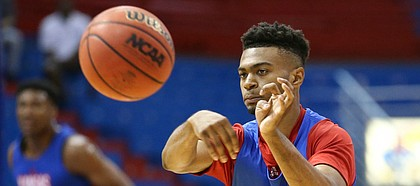 Kansas newcomer Issac McBride throws a pass during a scrimmage on Tuesday, June 11, 2019 at Allen Fieldhouse.