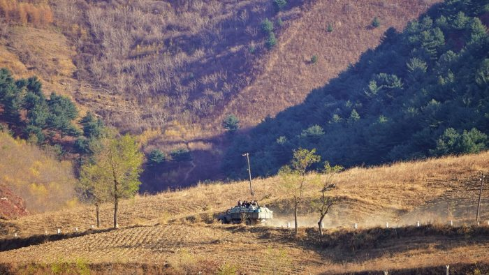 Local riding an old truck in Sinuiju, North Korea