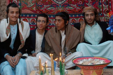 Yemeni Jew, Yussef Saeed Hamdi (R), 19, poses for a picture with unidentified guests on the first day of his traditional wedding party in the village of Raydah in Amran province, 70 kms north of Sanaa, on June 15, 2008. Hamdi is completing his studies in Jerusalem but he came back home to get married to a young woman from his community, according to relatives. A few hundred Jews still live in Yemen, but recent threats by rebels from the Zaidi minority made some leave their homes in the Saada province to the Sanaa region. Jews, like Muslims in tribal areas of Yemen, hold three-day wedding parties for their children who usually marry members of the same community. AFP PHOTO/KHALED FAZAA (Photo credit should read KHALED FAZAA/AFP/Getty Images)