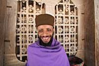 Ethiopian Monk in Monestary on island in Lake Tana. WorldRider Allan Karl gets him to smile.