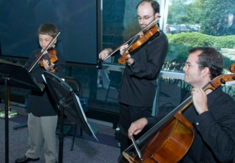 Playing for promotion reception -- age 10, Norfolk, Virginia