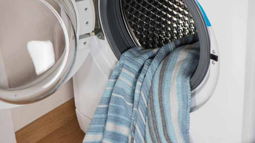 load-the-washing machine-with-proper-soap-and blankets