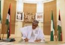 Buhari Signs New Minimum Wage Bill Into Law