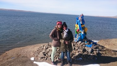 On a lake in Central Mongolia with buddhism coloumn