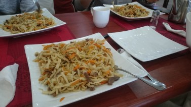 Tsuivan - traditional mongolian noodles with carrot and Beef