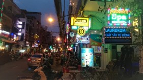 Night life in Saigon - everything you need on 5 meters_ laundry, bank, restaurant and hotel