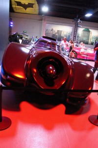 back view of the Batmobile. the Bat sign is on the ceiling above