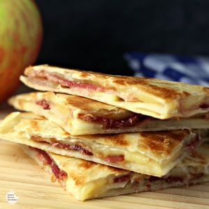 four pieces of Bacon Chicken Quesadilla on wooden board