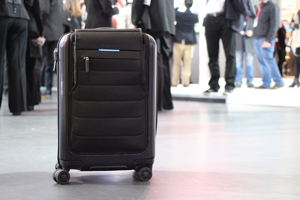 black carry on luggage in busy crowded place