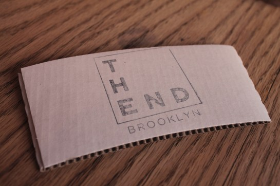 sleeve for coffee with the words the End Brooklyn on it