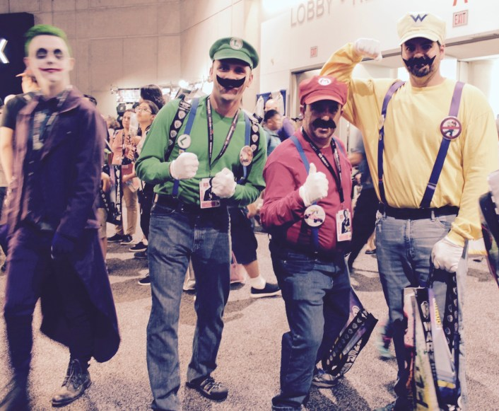 Mario brothers dressed in jeans and yellow, red and green shirts and hats