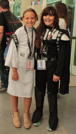 Two young girls dressed a s Princess Leia and Darth Vader
