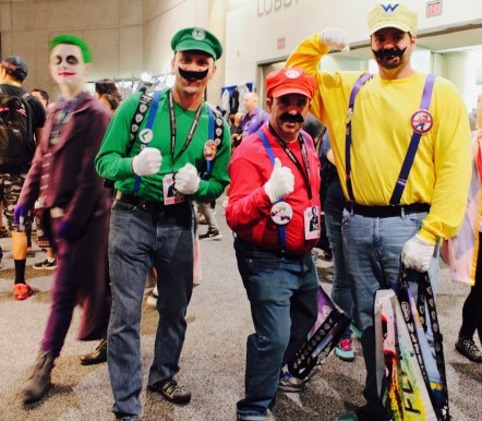 Joker creeps by as Mario brothers pose