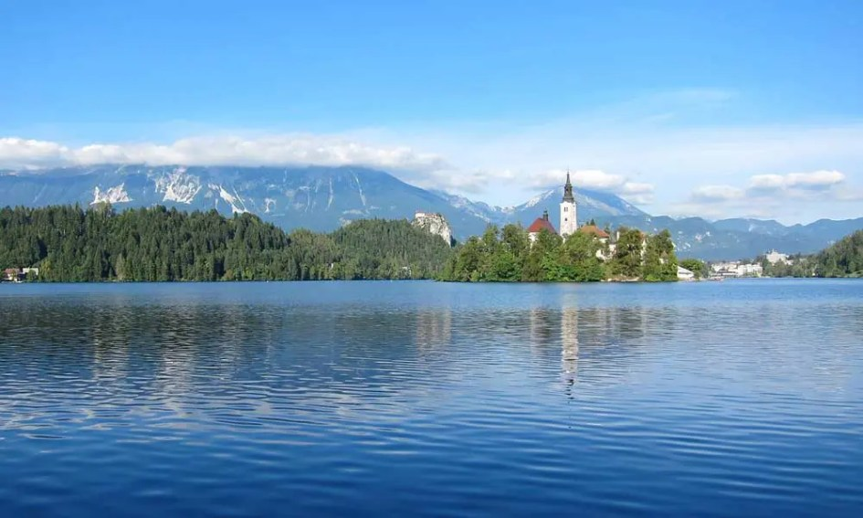 Spring holiday ideas - depicts Lake Bled and a castle in Slovenia