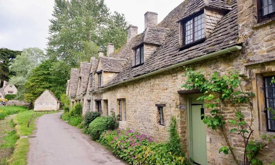 Depicts quaint village in the Cotswolds