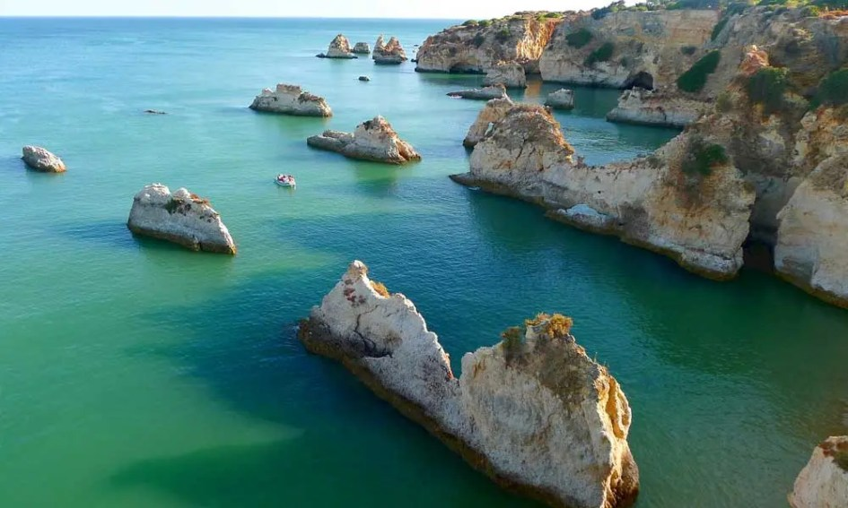 Best July beach holidays - Shows Algarve coastline rock formations