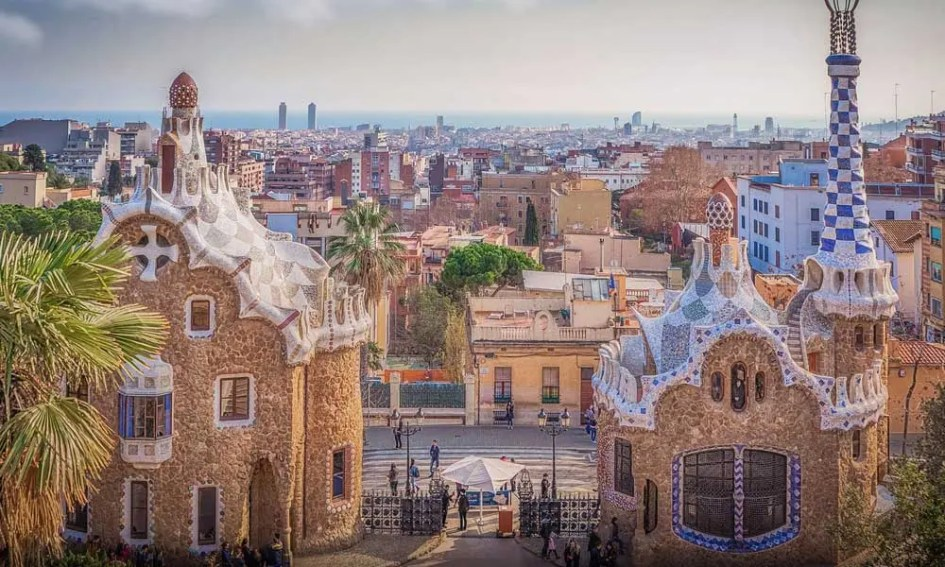 Depicts Park Guell in Barcelona - Best European city breaks in July