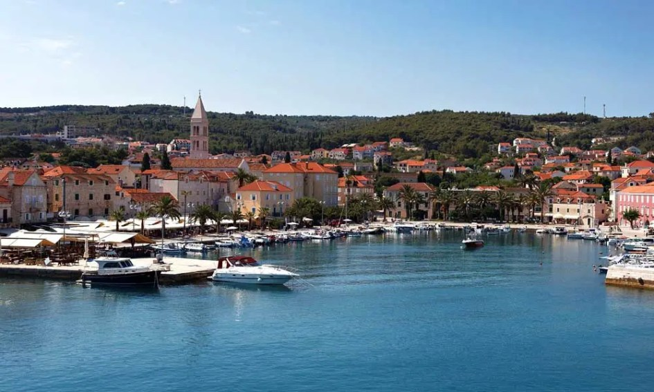 Where to go on a beach holiday in July - shows Hvar marina yachts