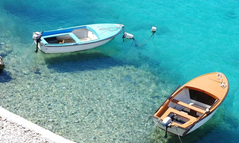 Things to do in Novalja - shows two boats by a beach