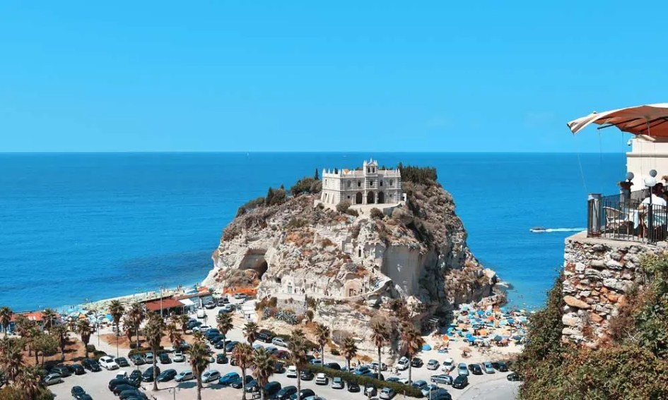 Best beach destinations in September - shows Tropea hill and beaches