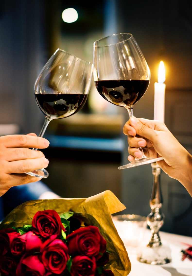 Couples enjoying wine on sunday date  at home