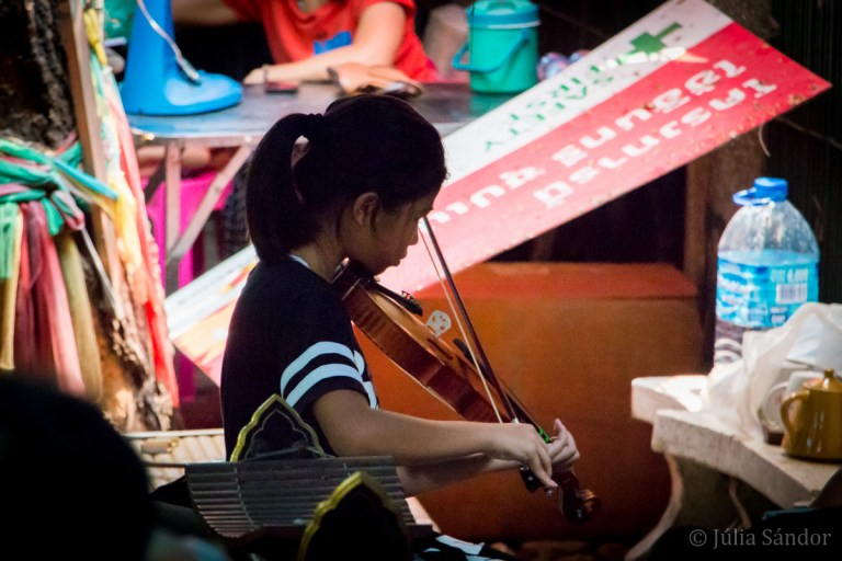 Violin playing girl in Bangkok