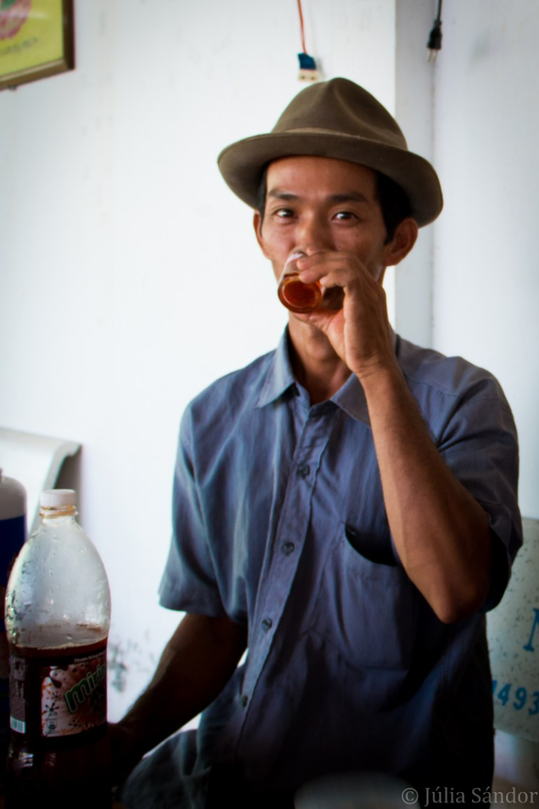 Vietnamese young man drinking tea