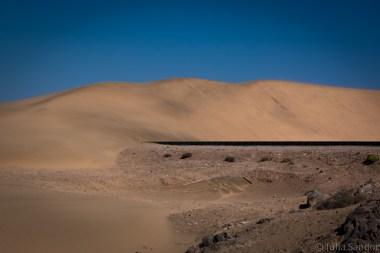 Railway running into dune