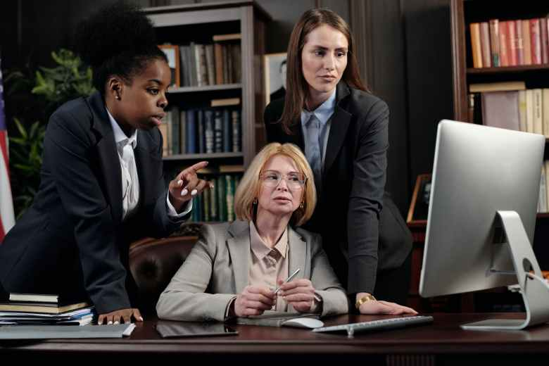 female lawyers in an office looking at a computer