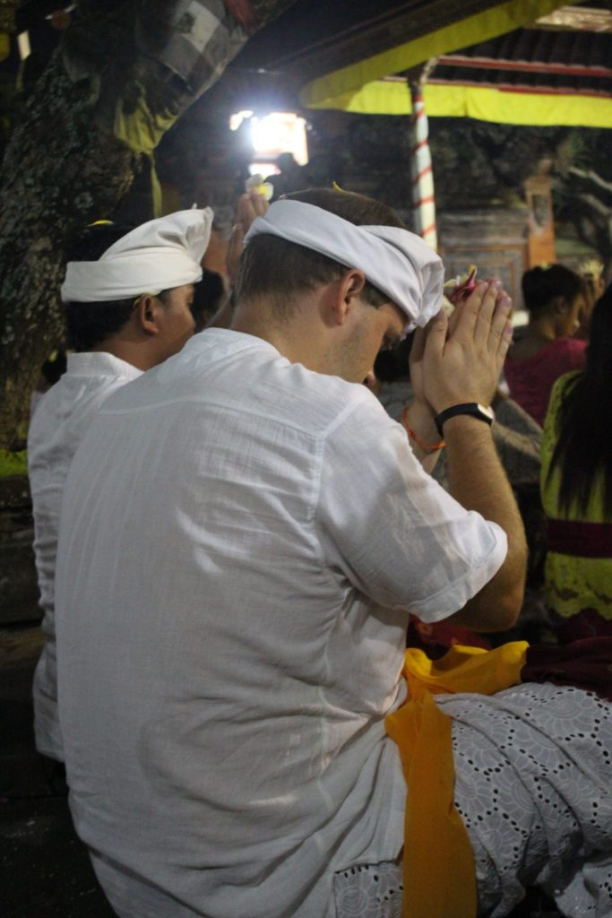 full moon ceremony bali praying flowers