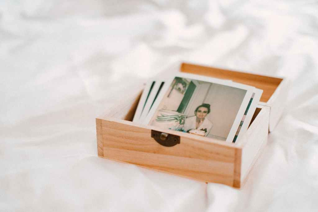 close up of pictures on wooden box