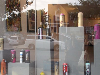 Front Window of Low Brow Artique with Spray Cans