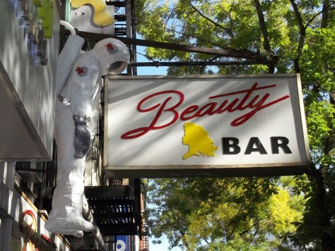 Hanging Astronaut with Beauty Bar Sign