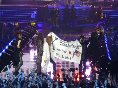 X Band on Stage with Banner