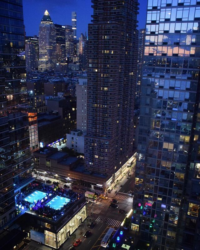 Silver Towers Nighttime Pool View