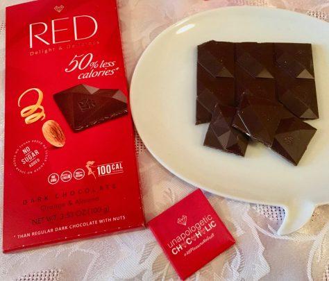 red orange almond dark chocolate with wrapper photo by gail worley