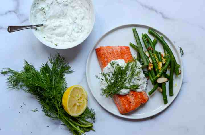 plate of salmon with dill tzatziki and green beans