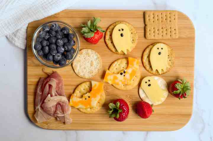 halloween charcuterie board with cheese and crackers
