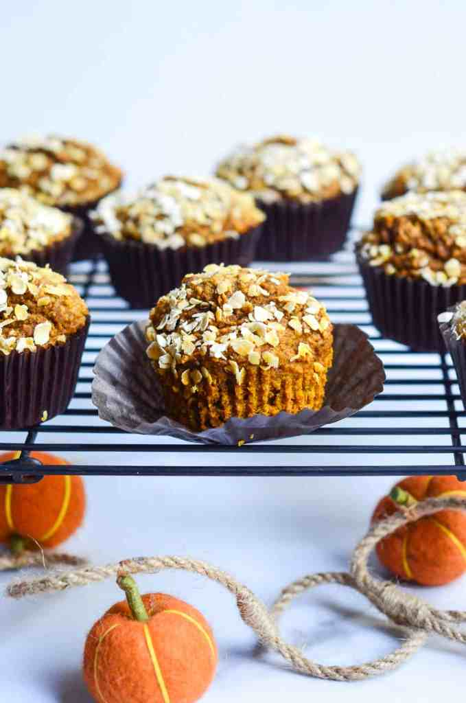 close up of one opened pumpkin muffin on cooling rack